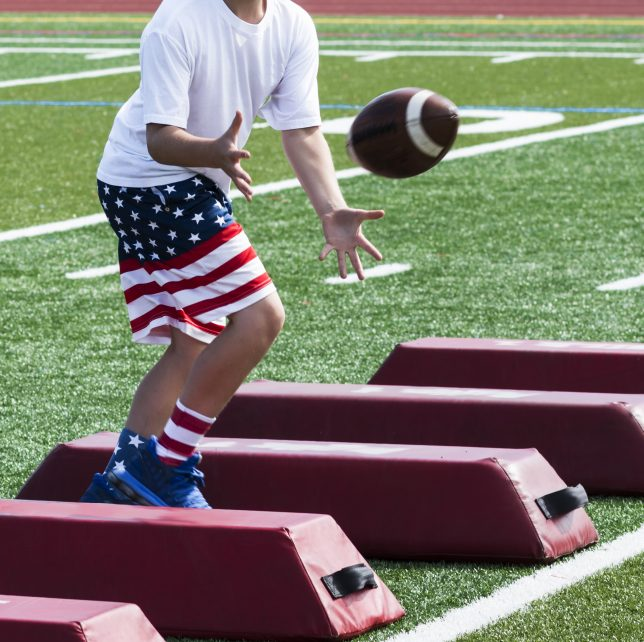 Football player wearing a pair of american flag running shorts